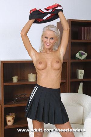 Sexy girl in cheerleader uniform stripping
